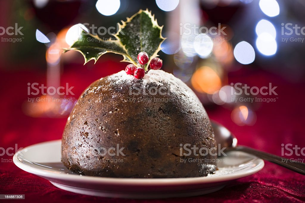 Christmas pudding with out of focus highlights stock photo