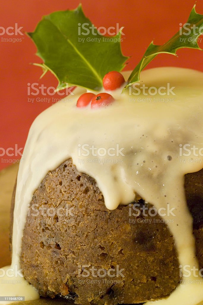 Christmas pudding with sauce,close up stock photo