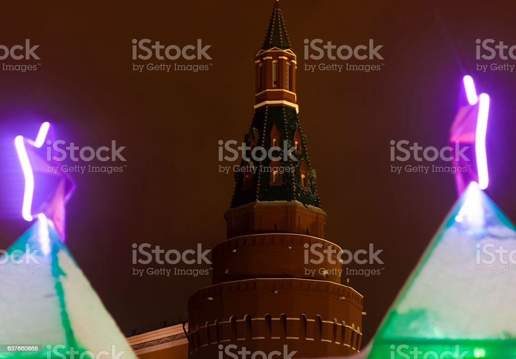 Christmas purple stars shine on the background of Kremlin stock photo
