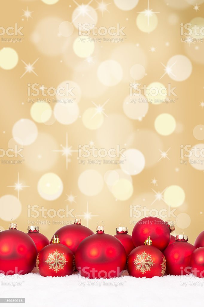 Christmas red balls decoration with golden background stock photo