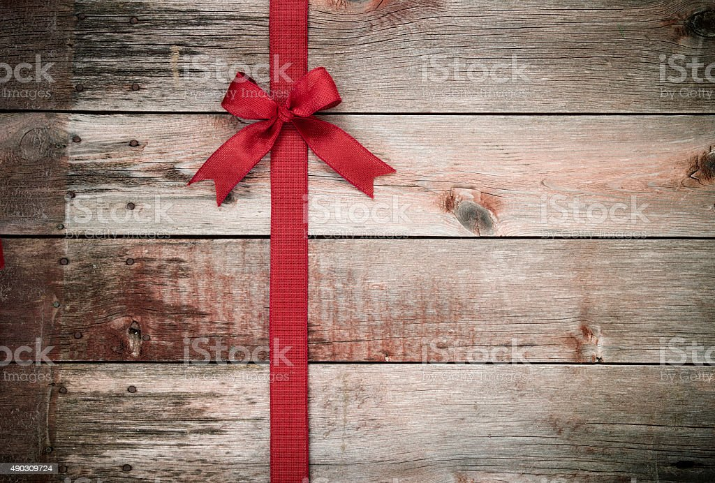 Christmas Red Bow on Wood Background stock photo