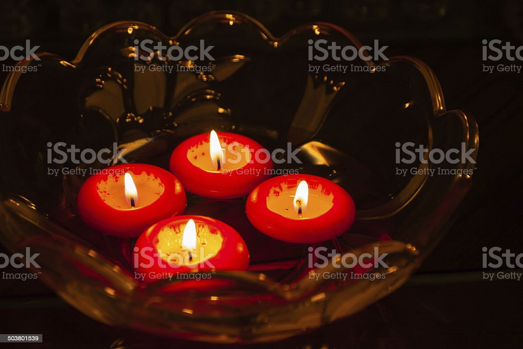 Christmas - Red candles afloat in glass bowl stock photo