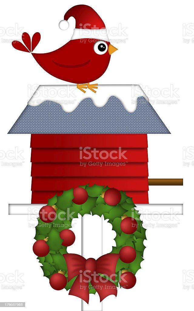 Christmas Red Cardinal Sitting on Birdhouse royalty-free stock photo