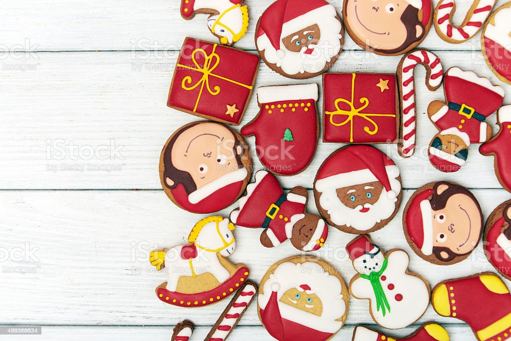 Christmas red gingerbread cookies on wooden background stock photo