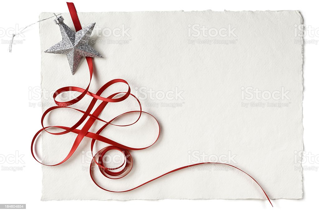 Christmas red ribbon and star on handmade paper royalty-free stock photo