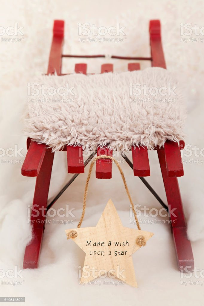 Christmas Red Sledge, with wooden star stock photo