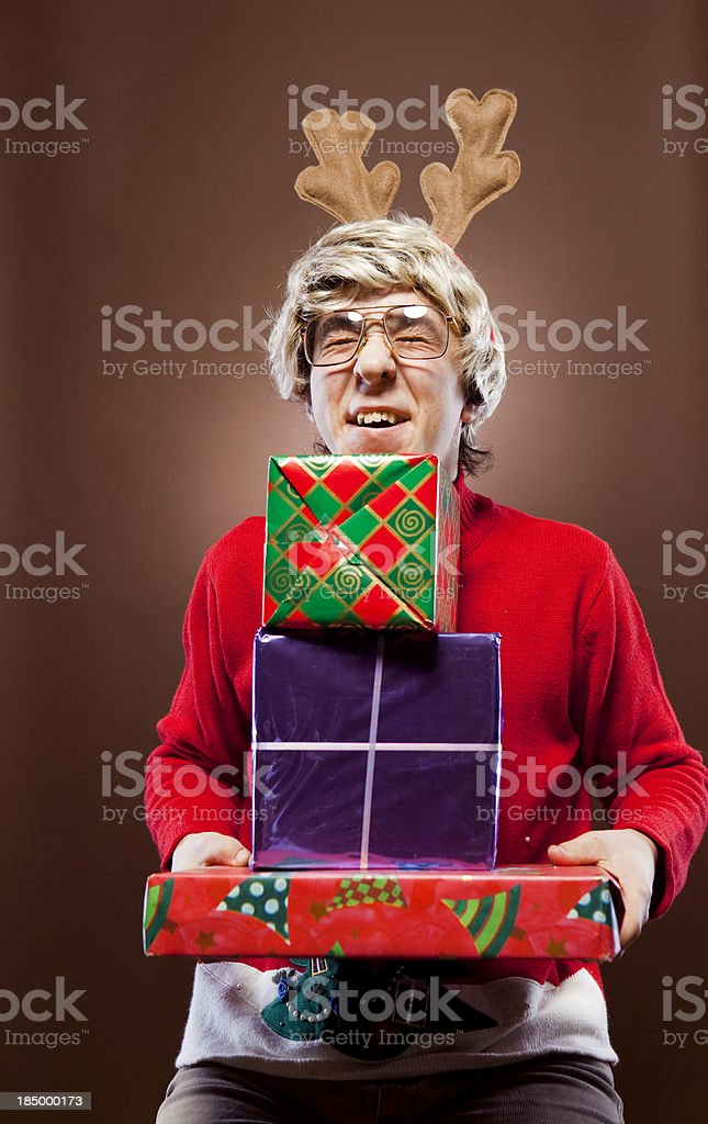 Christmas Reindeer Boy Receives Stack of Gifts royalty-free stock photo