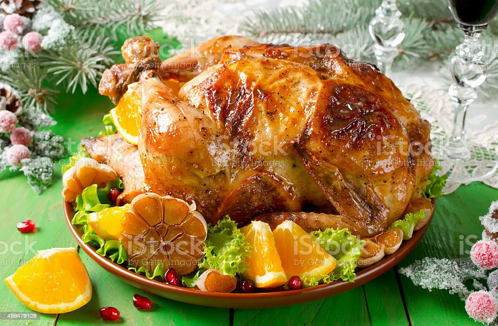 Christmas roast chicken with oranges stock photo