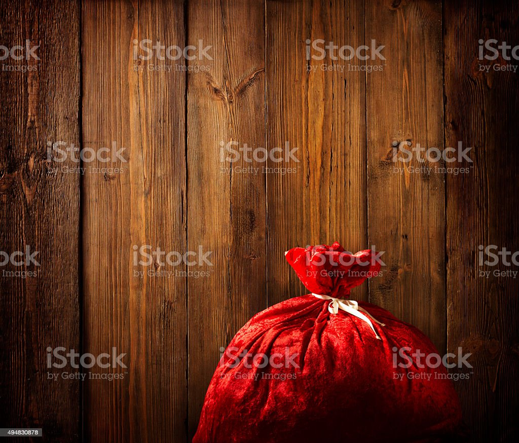 Christmas Santa Claus Bag Full, Wooden Background, Wood Plank Texture stock photo