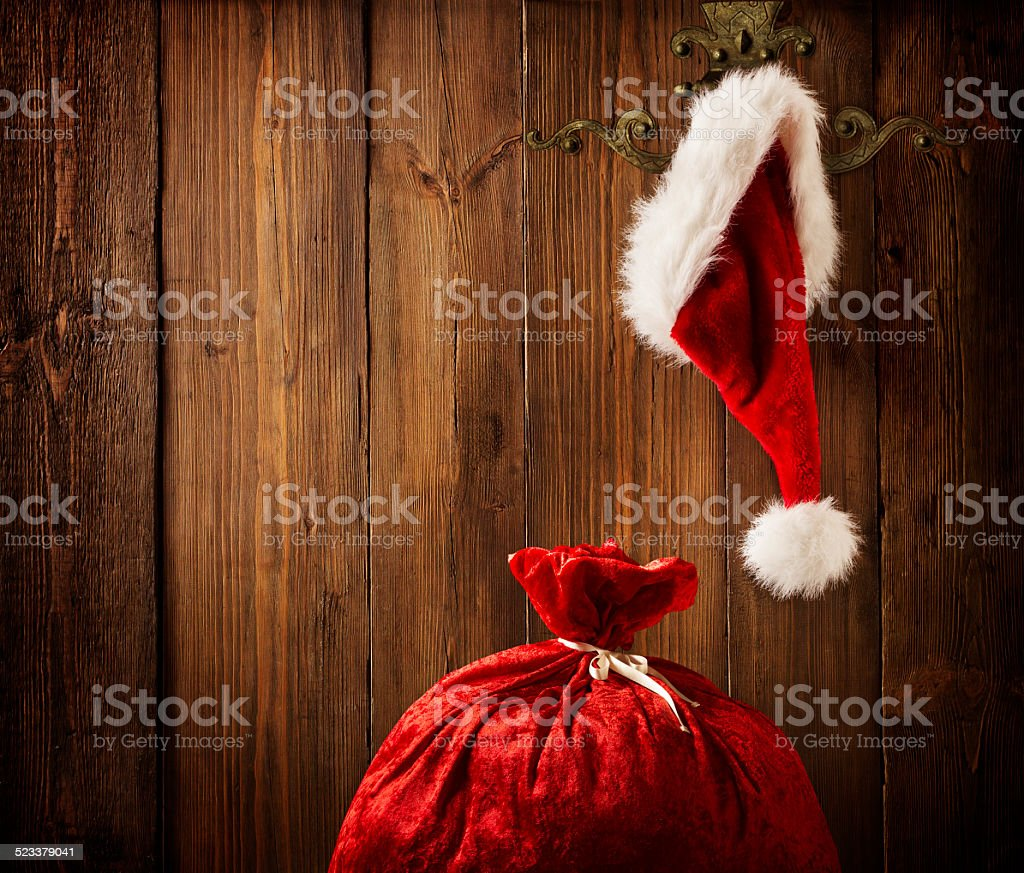 Christmas Santa Claus Hat Hanging On Wood Wall, Xmas Concept stock photo