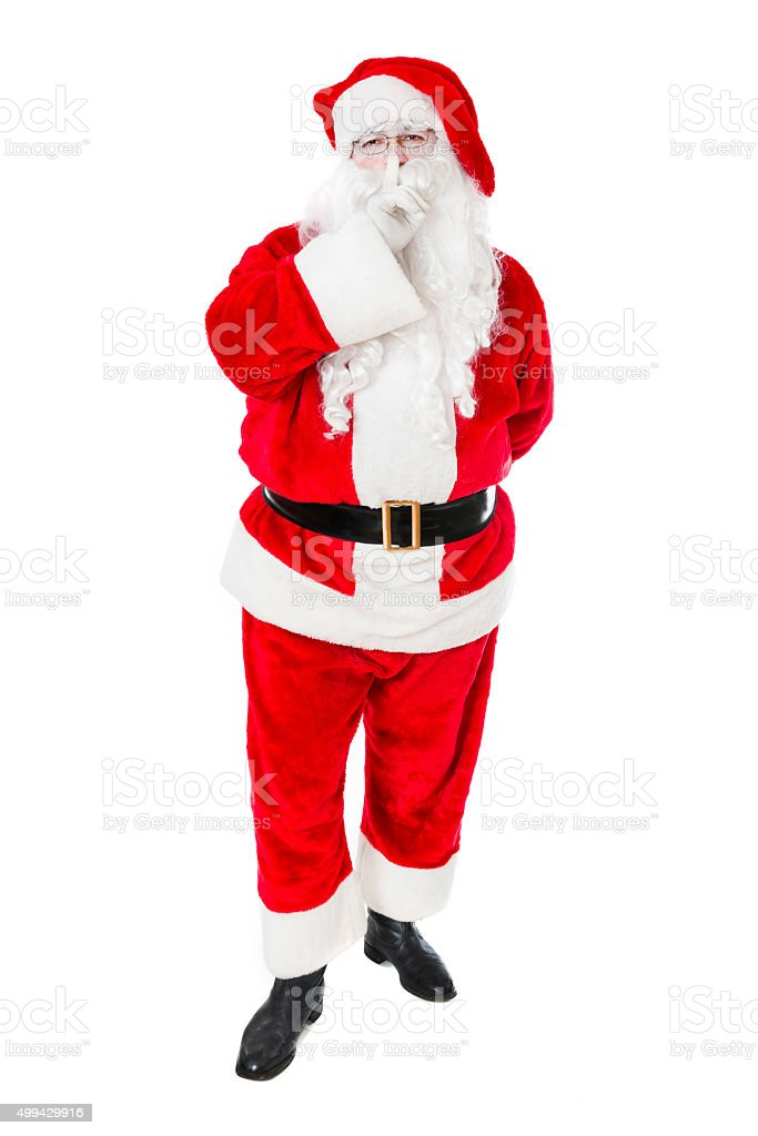 Christmas Santa Claus Holds his Finger for Being Quiet stock photo