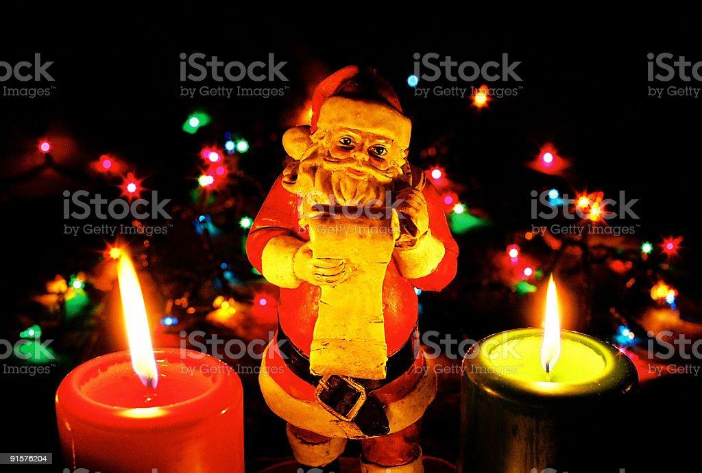 Christmas Santa Clause and candles royalty-free stock photo