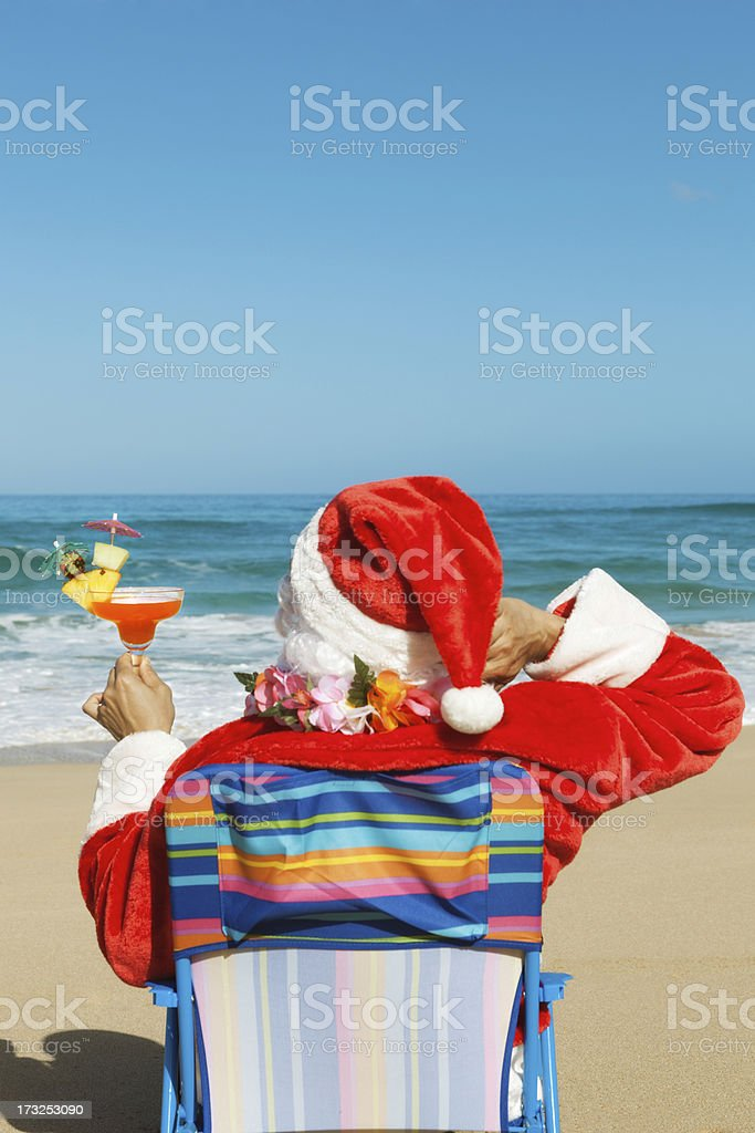 Christmas Santa Clause Vacationing on Tropical Beach with Drinks Vt royalty-free stock photo