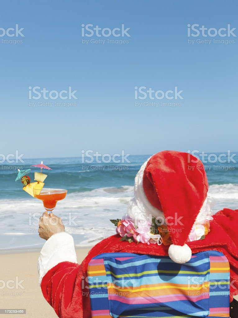 Christmas Santa Clause with Drinks Vacationing on Tropical Beach Close-up royalty-free stock photo