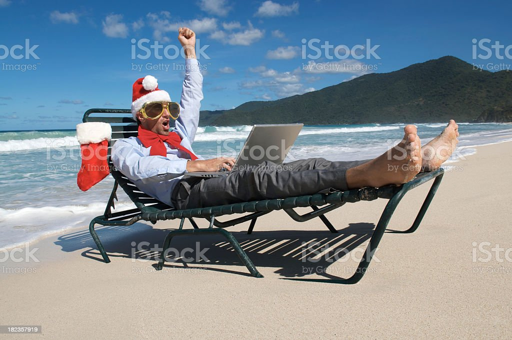 Christmas Santa Hat Businessman Hollering Holiday from Beach Chair royalty-free stock photo