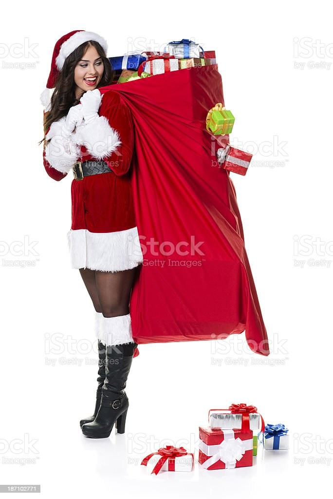Christmas santa woman carying red bag royalty-free stock photo