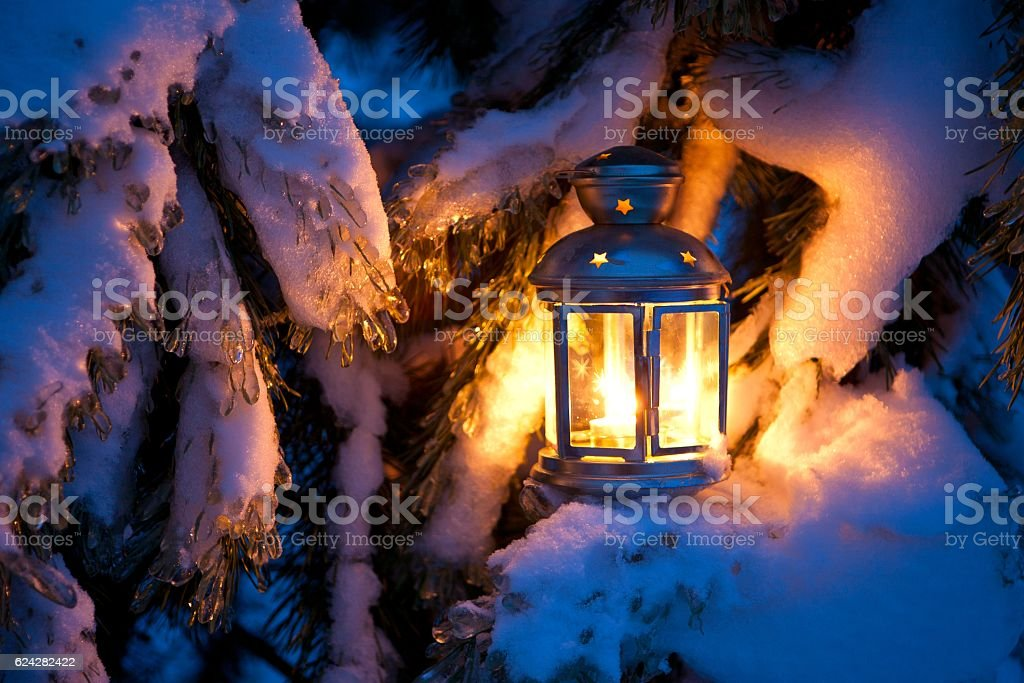 Christmas scene - an oil filled lantern burning bright with stock photo