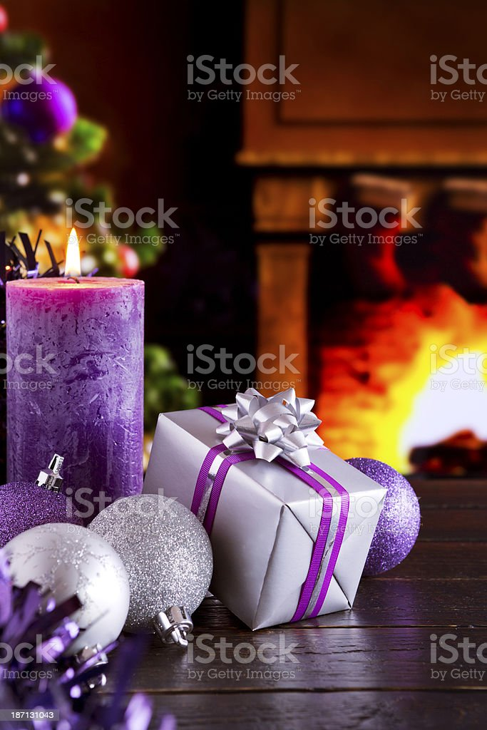 Christmas scene with fireplace and Christmas tree in the background royalty-free stock photo