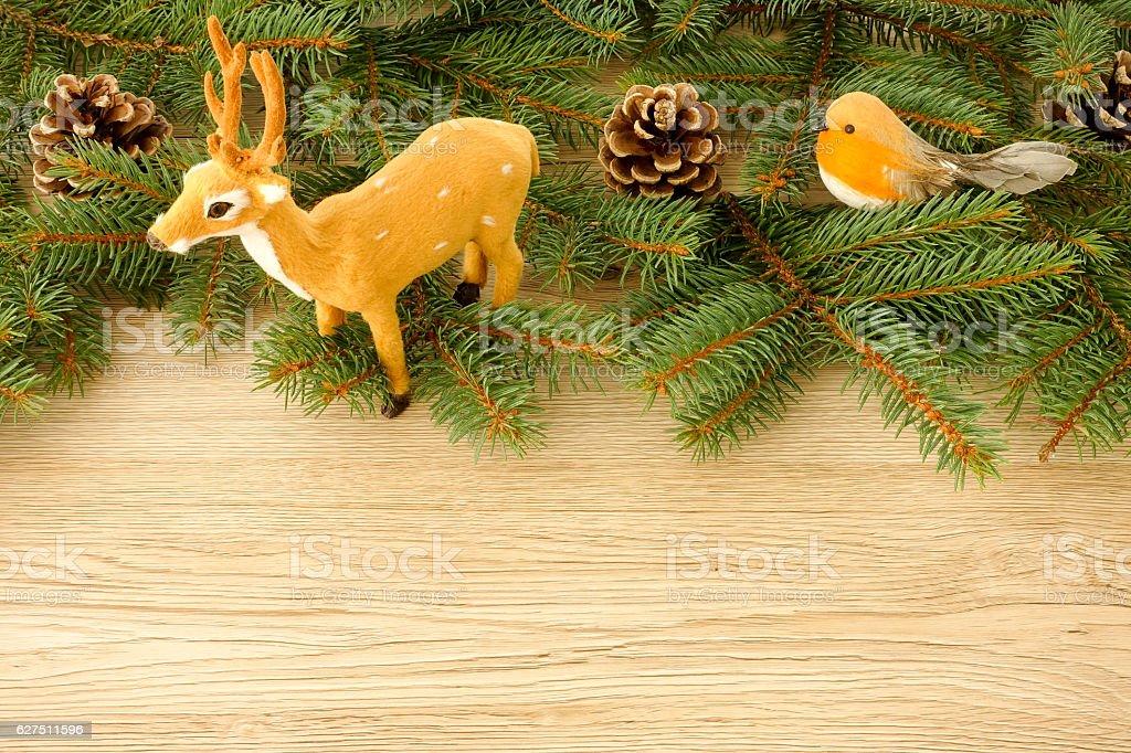 Christmas Scene with Reindeer, Bird, Pine Cones and Fir Twigs stock photo