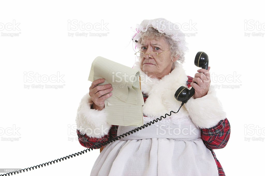 Christmas: Senior Mrs Claus with notepad and phone stock photo