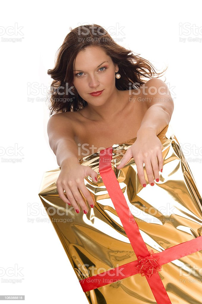 Christmas series - Beautiful woman behind big golden gift royalty-free stock photo