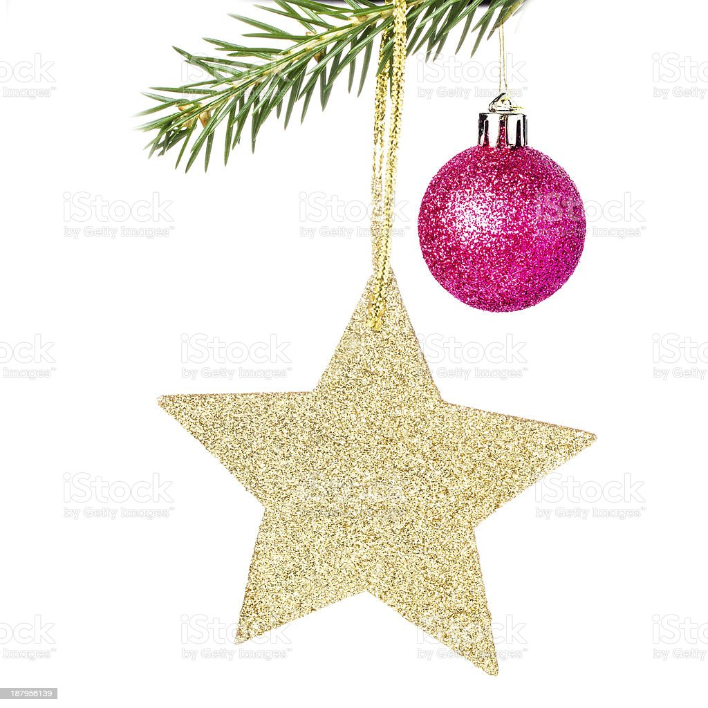 Christmas shiny golden star  on fir branches with decorations  I royalty-free stock photo