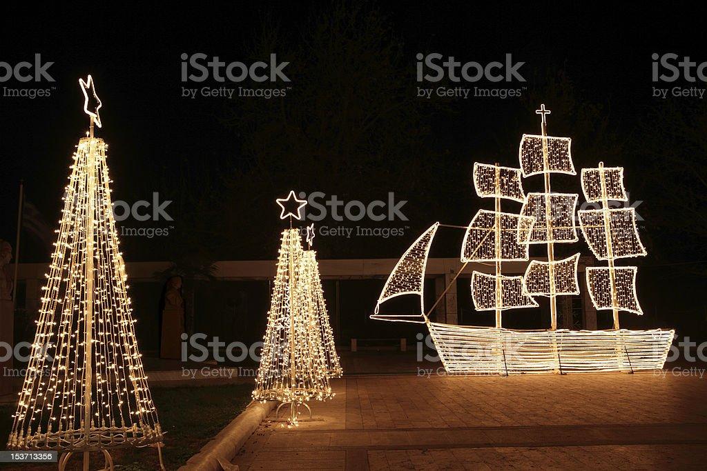Christmas ship and trees at night stock photo