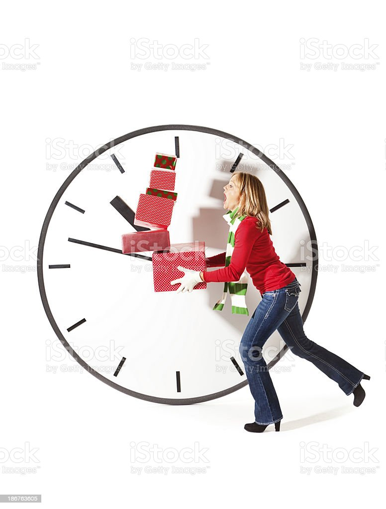 Christmas Shoppers Hurrying to Beat the Clock Shopping Deadline royalty-free stock photo