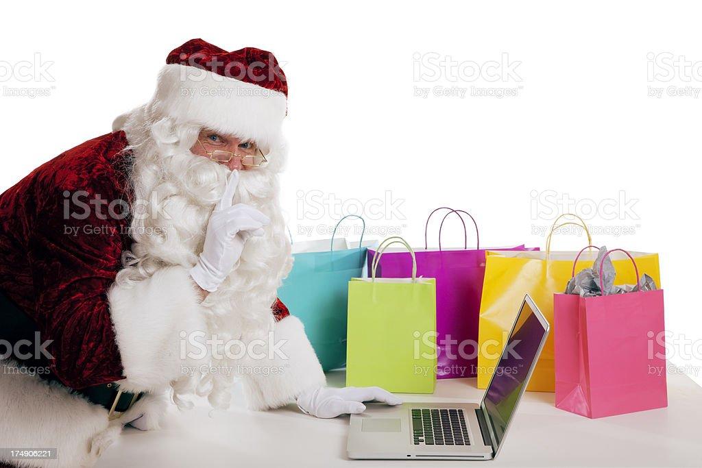 Christmas Shopping Secret by Santa Claus stock photo