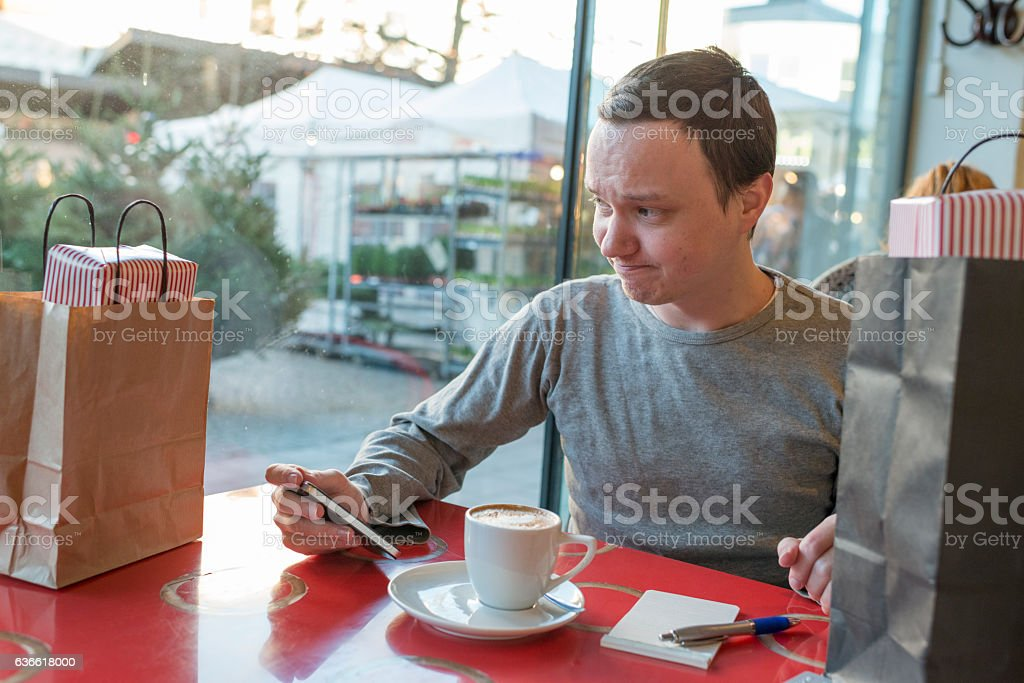 Christmas shopping, sitting in a cafe, phone in hand stock photo