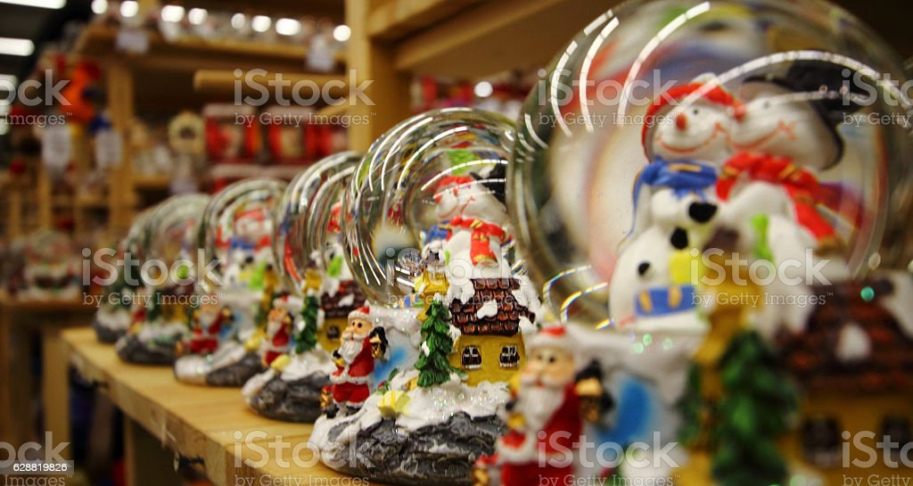Christmas shopping. Snowballs with snowmans at decoration store stock photo