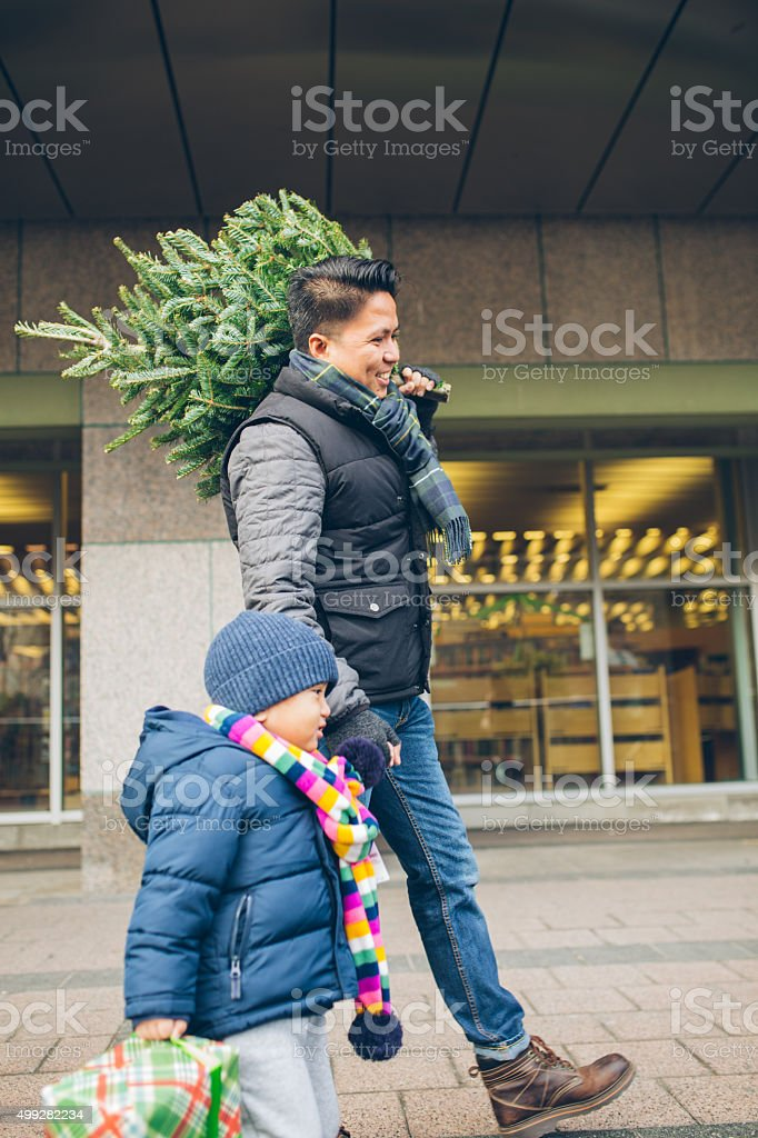 Christmas shopping with dad stock photo