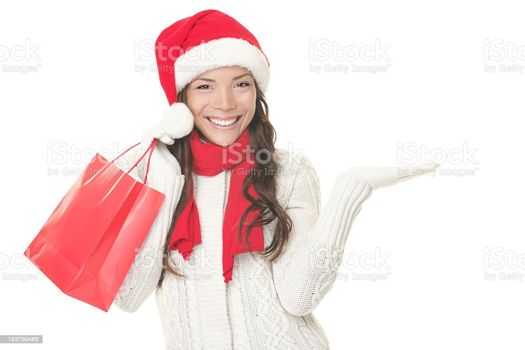 Christmas shopping woman showing copyspace excited royalty-free stock photo