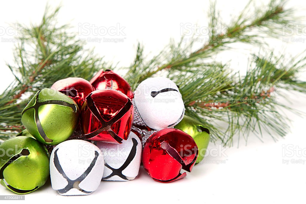 Christmas sleigh bells and pine branch stock photo