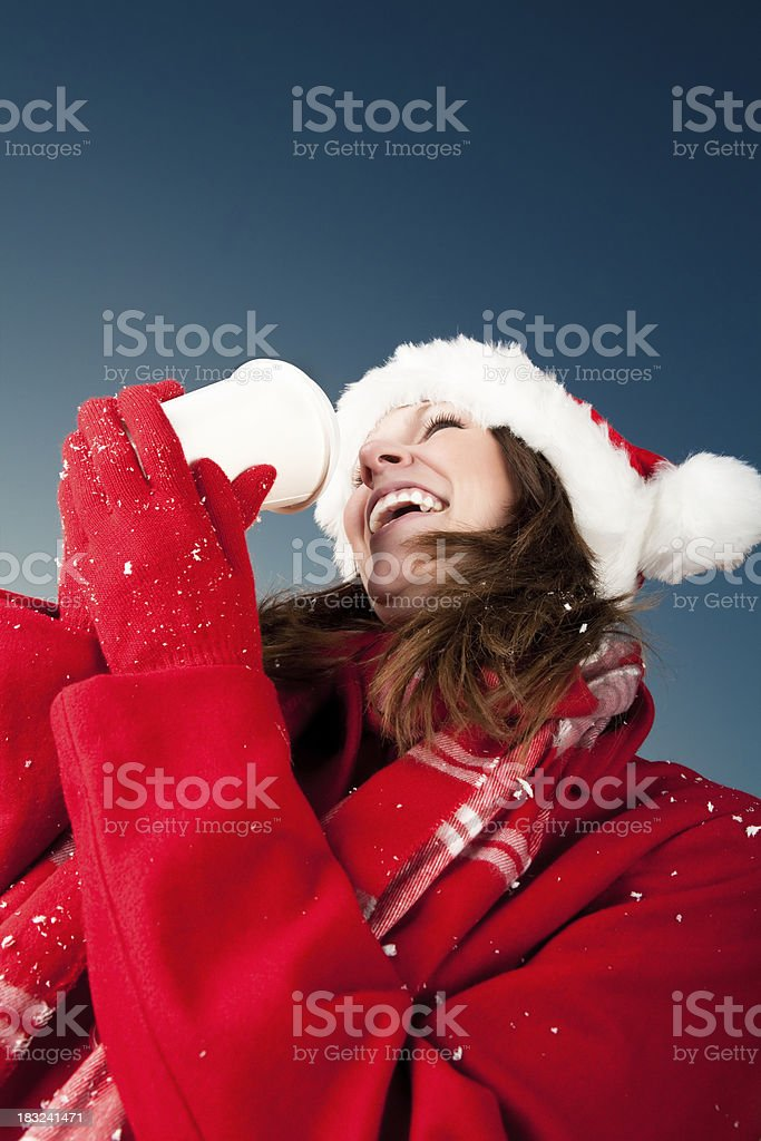 Christmas: Smiling woman holding coffee cup royalty-free stock photo
