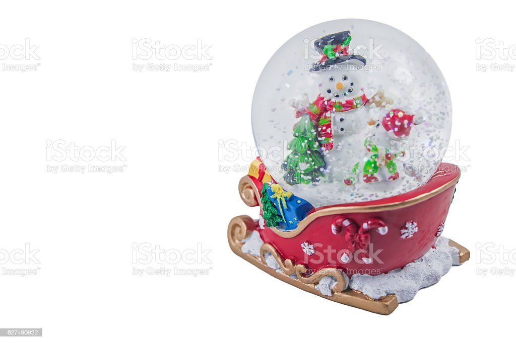Christmas snow globe with snowman isolated on white background stock photo