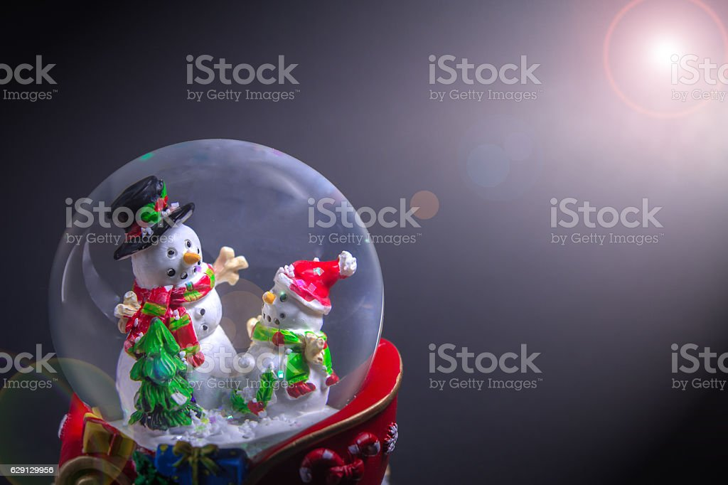 Christmas snow globe with snowman with len flare effect stock photo