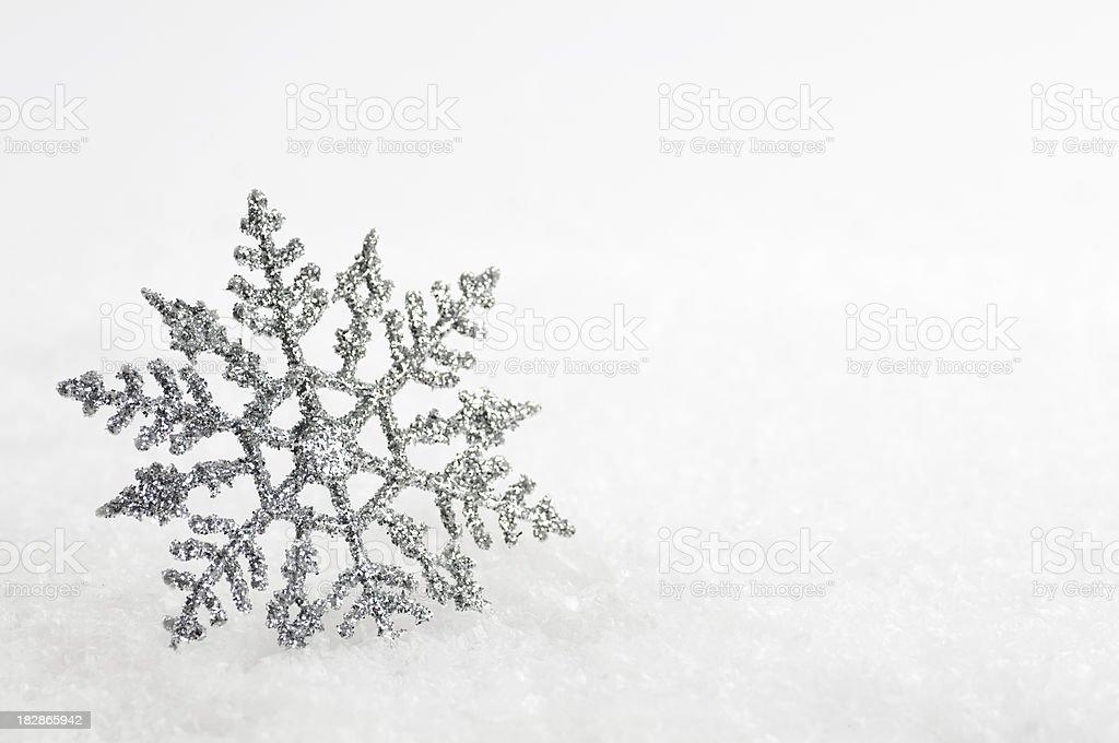 Christmas snowflake decoration on snow background royalty-free stock photo