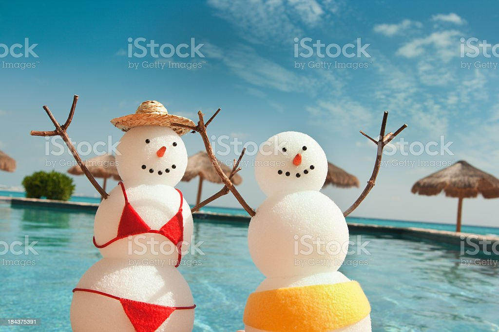 Christmas Snowman Enjoying Winter Beach Vacation Fun by Swimming Pool stock photo