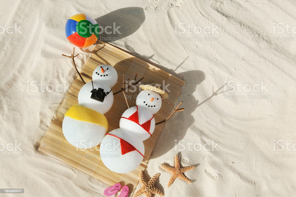 Christmas Snowman Winter Holiday Vacation on Tropical Beach stock photo