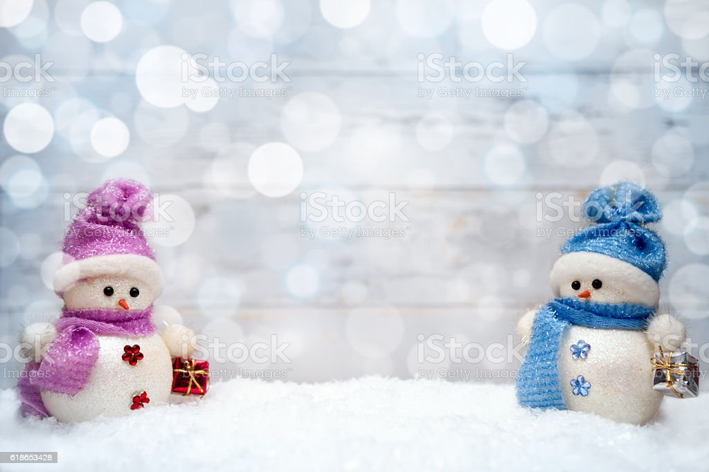 Christmas snowmen couple with presents stock photo