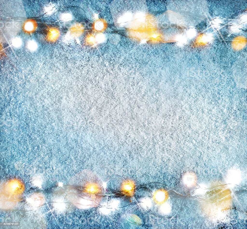 Christmas snowy background with garland stock photo