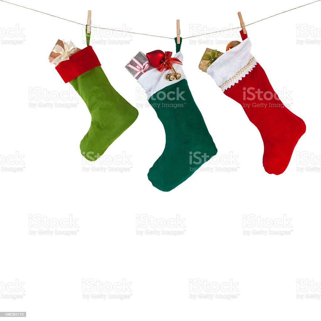 Christmas socks hanging on the rope with clothespins. isolated stock photo
