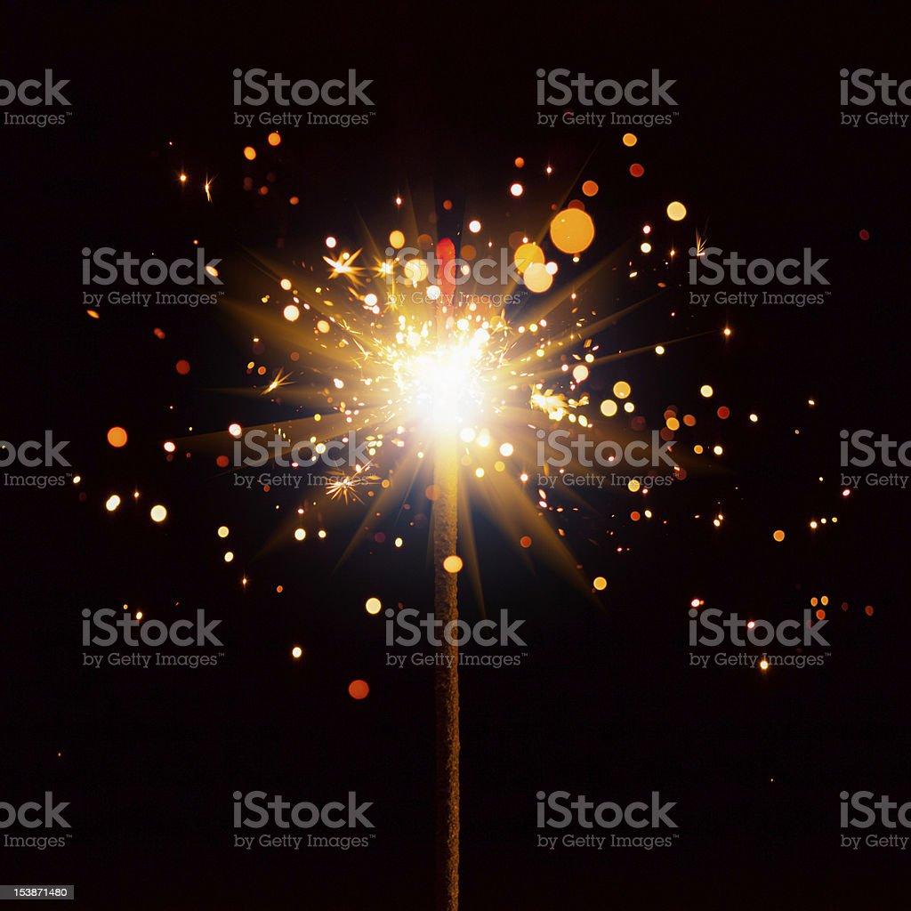 Christmas sparkler firing in the dark stock photo