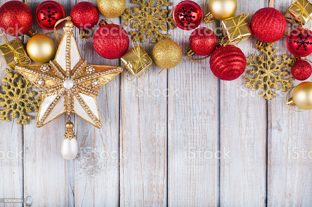 Christmas star and balls on wooden table. stock photo