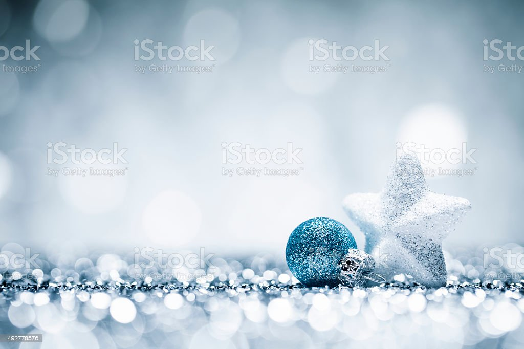 Christmas Star - Glitter Lights Bokeh Defocused Decoration Blue White stock photo