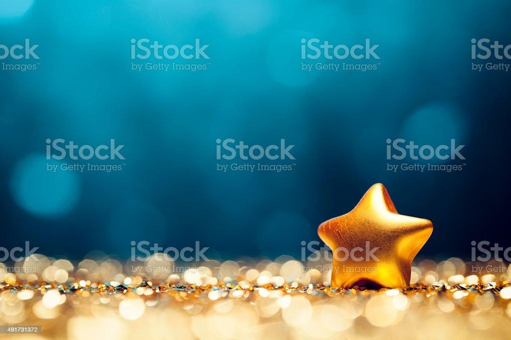 Christmas Star - Glitter Lights Bokeh Defocused Decoration Gold Blue stock photo