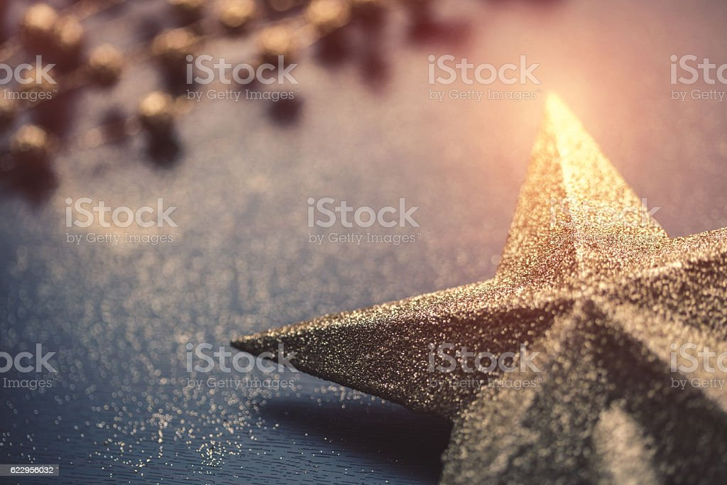 Christmas star on dark wooden background stock photo