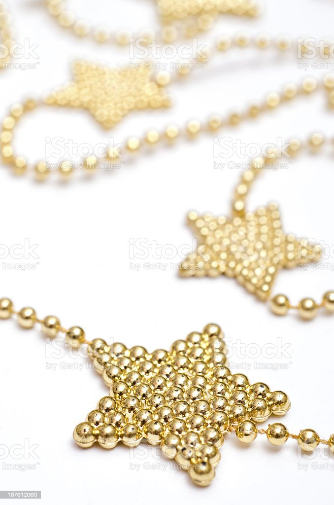 Christmas star with golden pearls royalty-free stock photo