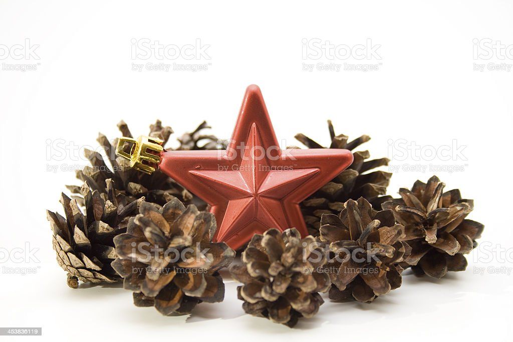 Christmas star with pine cone stock photo